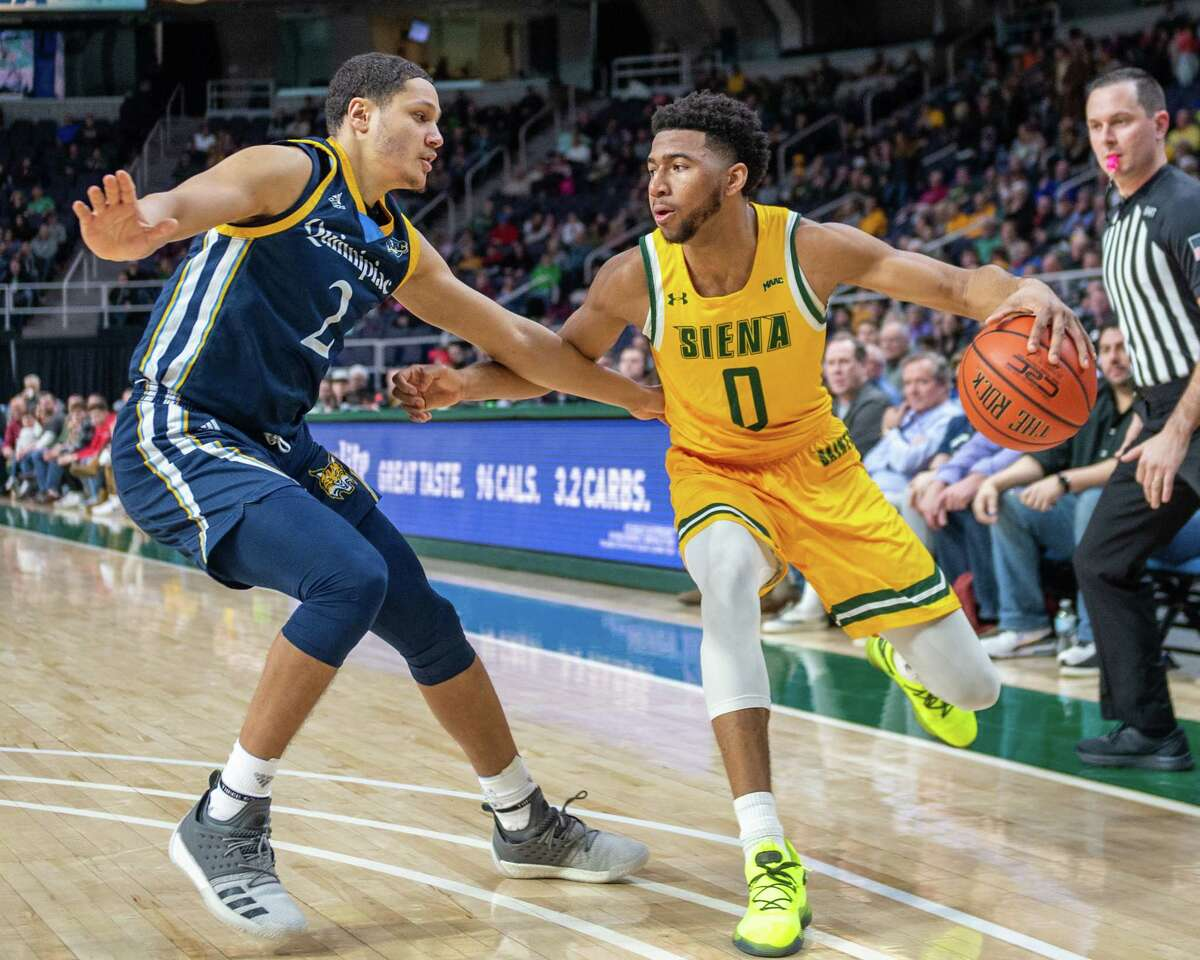 Siena sophomore Donald Carey dribbles up court in front of Quinnipiac freshman Matt Balanc at the Times Union Center in Albany NY on Sunday, Jan. 26, 2019 (Jim Franco/Special to the Times Union.)