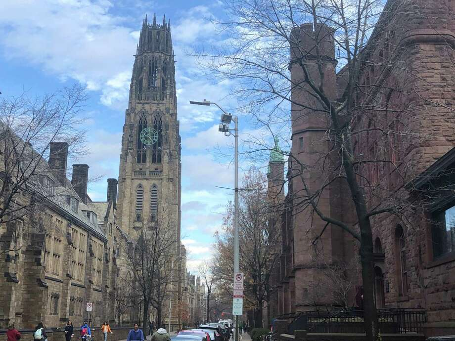 A view down High Street on the Yale University campus in New Haven, with Harkness Tower at left and Linsly-Chittenden Hall at right. Dwight Hall lies beyond Linsly-Chittenden; both are part of the Old Campus quad. Photo: Ed Stannard / Hearst Connecticut Media