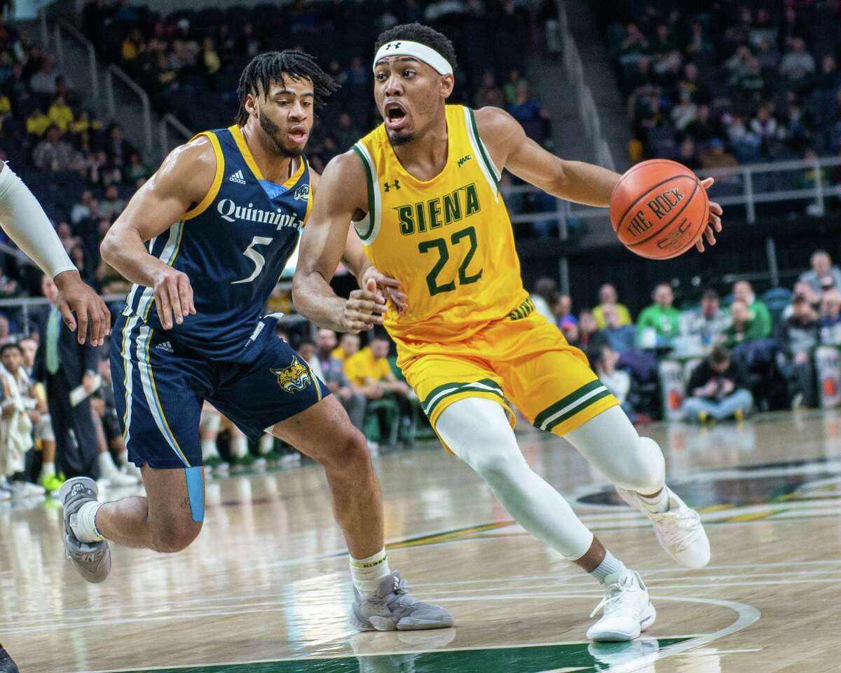 Siena sophomore Jalen Pickett drives to the basket in front of Quinnipiac sophomore Tyrese Williams at the Times Union Center in Albany NY on Sunday, Jan. 26, 2019 (Jim Franco/Special to the Times Union.)