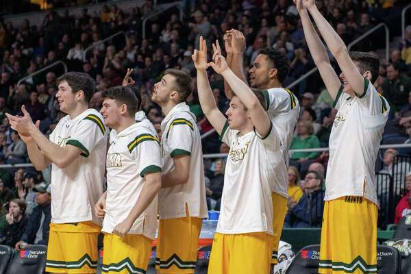 The Siena bench celebrates a win over Quinnipiac at the Times Union Center in Albany NY on Sunday, Jan. 26, 2019 (Jim Franco/Special to the Times Union