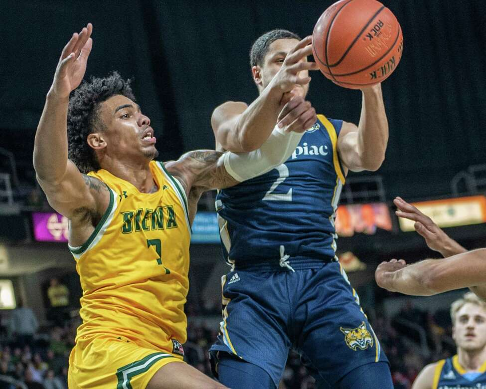 Siena junior Manny Camper fights for a rebound with Quinnipiac freshman Matt Balanc at the Times Union Center in Albany NY on Sunday, Jan. 26, 2019 (Jim Franco/Special to the Times Union.)