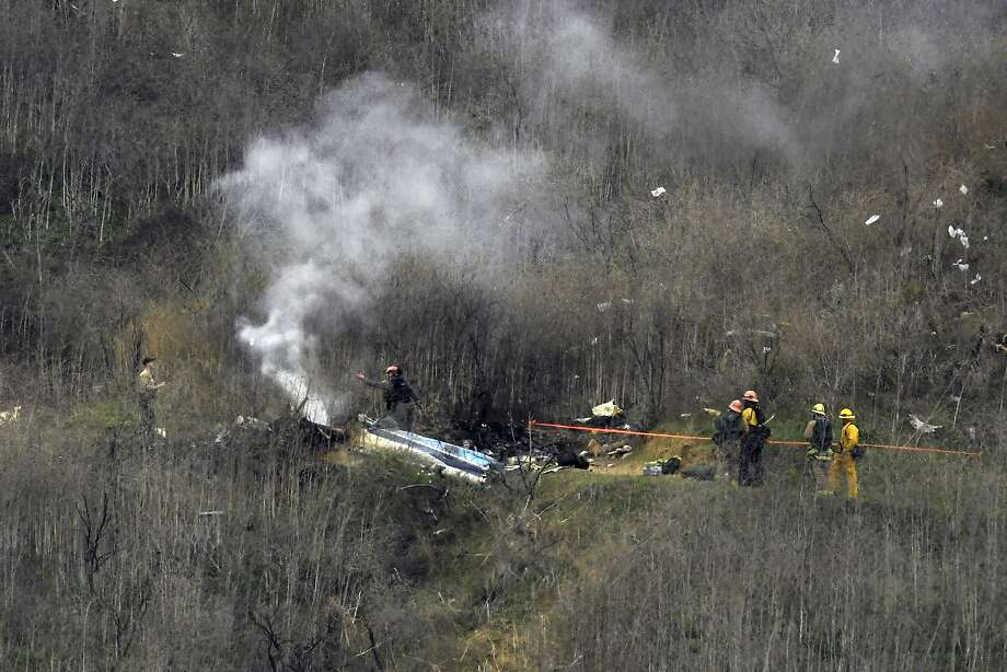 Firefighters work the scene of a helicopter crash Sunday, Jan. 26, 2020, in Calabasas, Calif. NBA basketball legend Kobe Bryant, his teenage daughter Gianna and three others were killed in the crash in Southern California on Sunday. (AP Photo/Mark J. Terrill) Photo: Mark J. Terrill, Associated Press