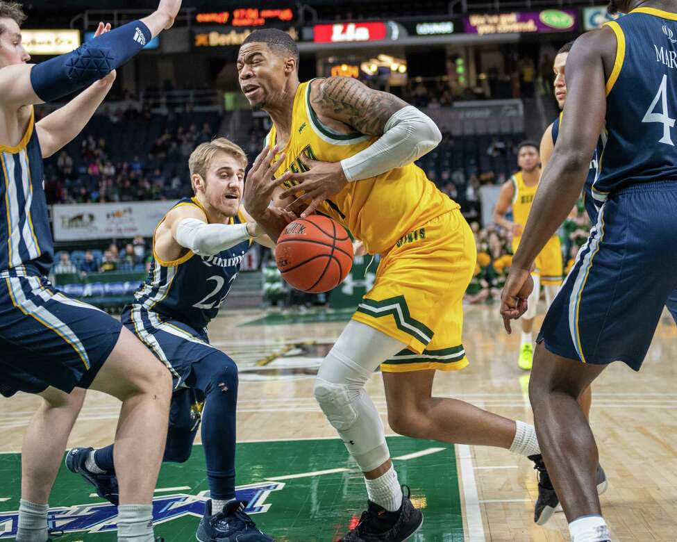 Siena forward Elijah Burns fights for a rebound against Quinnipiac at the Times Union Center in Albany NY on Sunday, Jan. 26, 2019 (Jim Franco/Special to the Times Union.)
