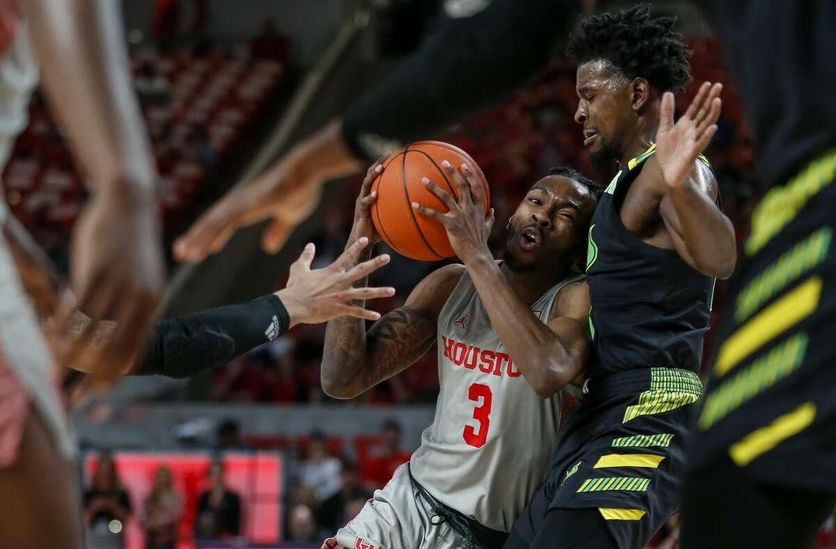 Houston Cougars guard DeJon Jarreau (3) tries to drive to the basket against South Florida Bulls forward Justin Brown (13) during the second half of an NCAA game at the Fertitta Center Sunday, Jan. 26, 2020, in Houston. The Cougars won 68-49.