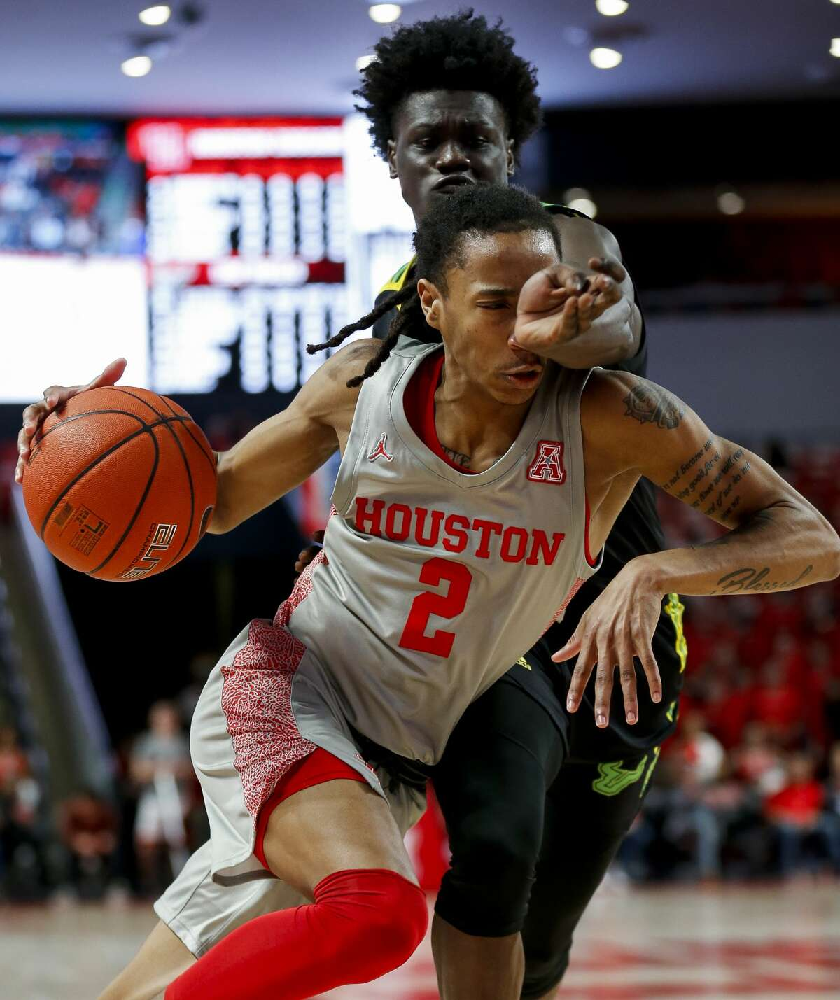 Houston Cougars guard Caleb Mills (2) tries to get to the basket against South Florida Bulls guard Ezacuras Dawson III (2) during the second half of an NCAA game at the Fertitta Center Sunday, Jan. 26, 2020, in Houston. The Cougars won 68-49.
