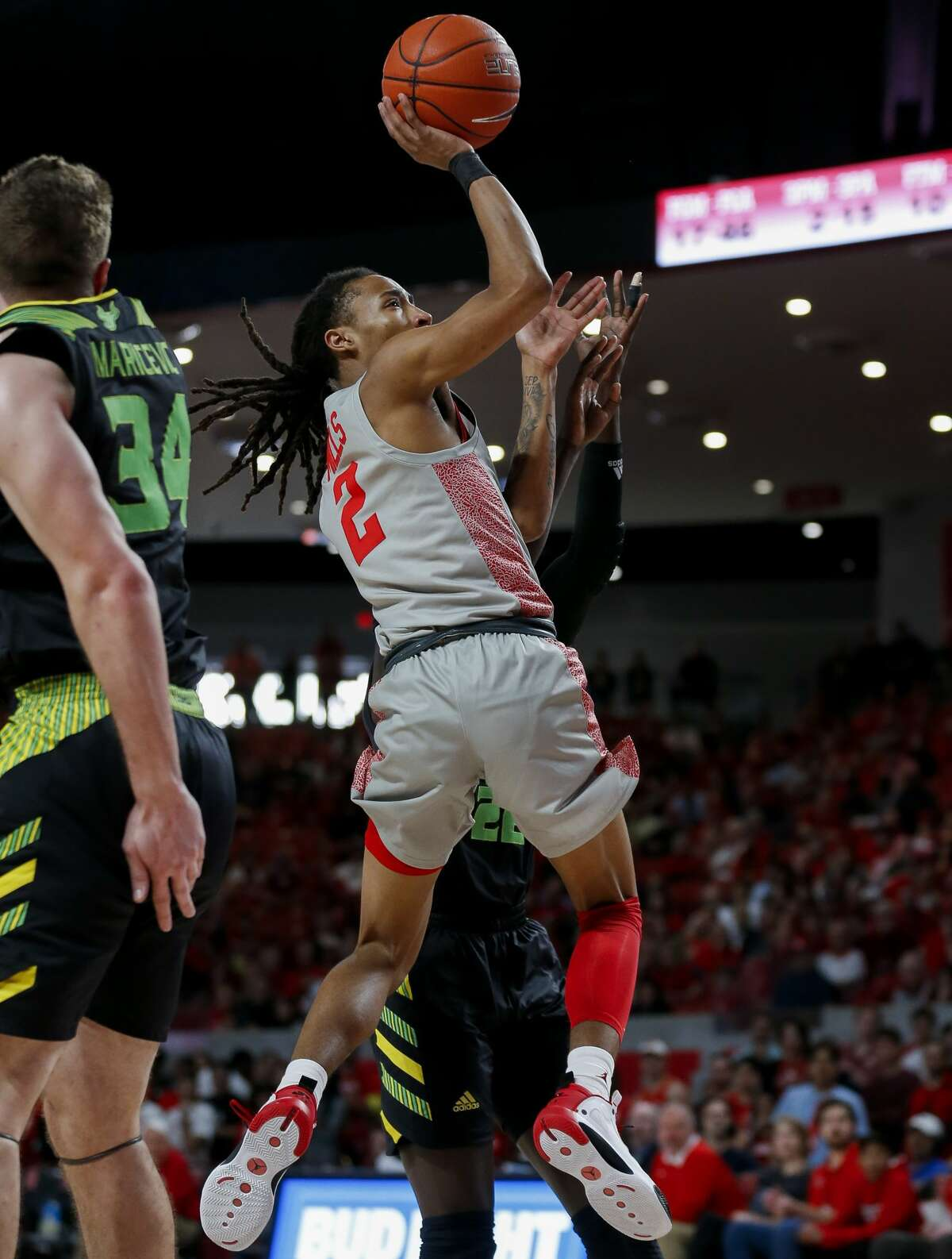 Houston Cougars guard Caleb Mills (2) shoots the ball against the South Florida Bulls during the second half of an NCAA game at the Fertitta Center Sunday, Jan. 26, 2020, in Houston. The Cougars won 68-49.
