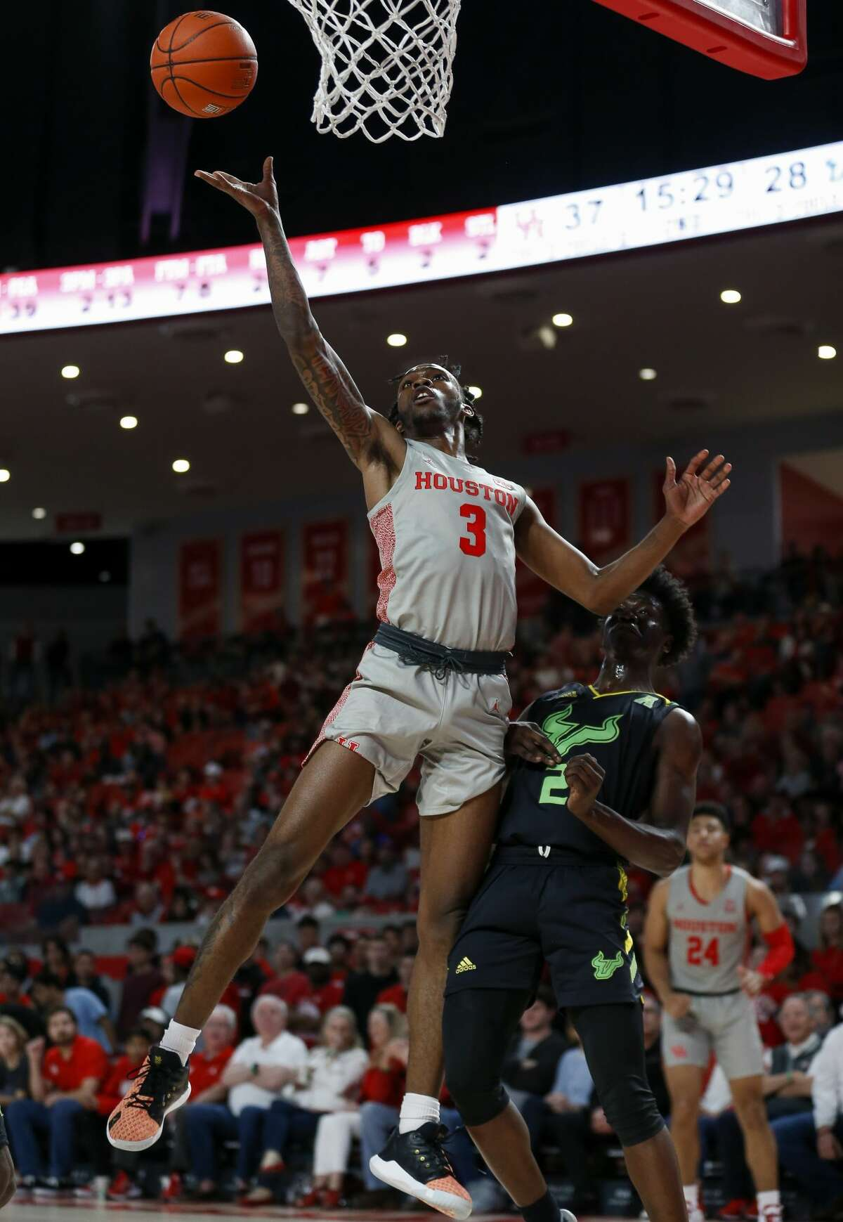 Houston Cougars guard DeJon Jarreau (3) shoots the ball against South Florida Bulls guard Ezacuras Dawson III (2) during the second half of an NCAA game at the Fertitta Center Sunday, Jan. 26, 2020, in Houston. The Cougars won 68-49.