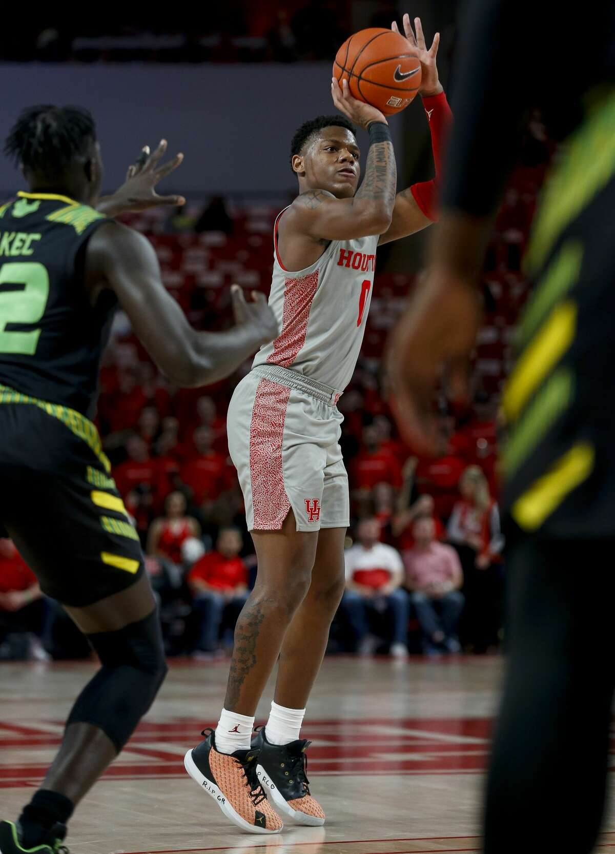 Houston Cougars guard Marcus Sasser (0) shoots a three-pointer against the South Florida Bulls during the second half of an NCAA game at the Fertitta Center Sunday, Jan. 26, 2020, in Houston. The Cougars won 68-49.