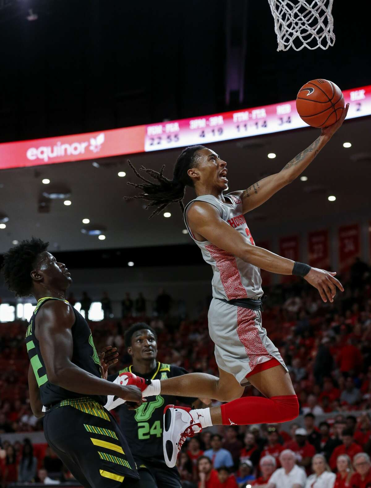 Houston Cougars guard Caleb Mills (2) scores a layup against the South Florida Bulls during the second half of an NCAA game at the Fertitta Center Sunday, Jan. 26, 2020, in Houston. The Cougars won 68-49.