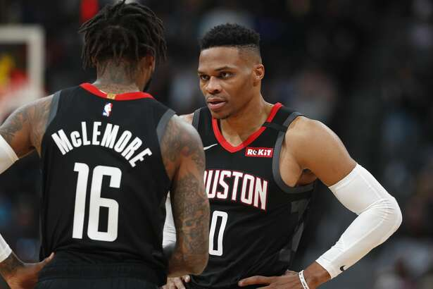 Houston Rockets guard Ben McLemore (16) confers with guard Russell Westbrook in the first half of an NBA basketball game against the Denver Nuggets, Sunday, Jan. 26, 2020, in Denver. (AP Photo/David Zalubowski)