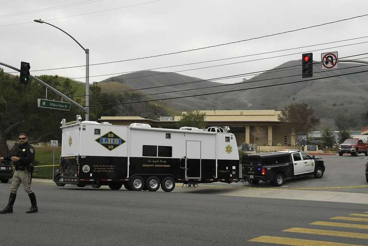 A Sheriffs Department vehicle arrives at the scene of a helicopter crash that killed former NBA basketball player Kobe Bryant Sunday, Jan. 26, 2020, in Calabasas, Calif. (AP Photo/Mark J. Terrill)