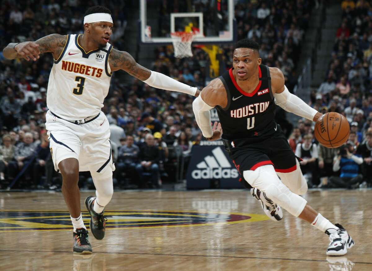 Houston Rockets guard Russell Westbrook, right, drives to the rim past Denver Nuggets forward Torrey Craig in the first half of an NBA basketball game Sunday, Jan. 26, 2020, in Denver. (AP Photo/David Zalubowski)