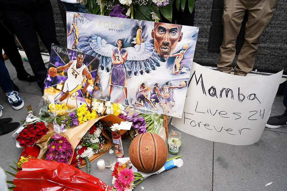 LOS ANGELES, CALIFORNIA - JANUARY 26: Flowers and tributes are left at a makeshift memorial for former NBA player Kobe Bryant outside the 62nd Annual GRAMMY Awards at STAPLES Center on January 26, 2020 in Los Angeles, California. Bryant, 41, died today in a helicopter crash in near Calabasas, California. (Photo by Rachel Luna/Getty Images) Photo: Rachel Luna, Getty Images