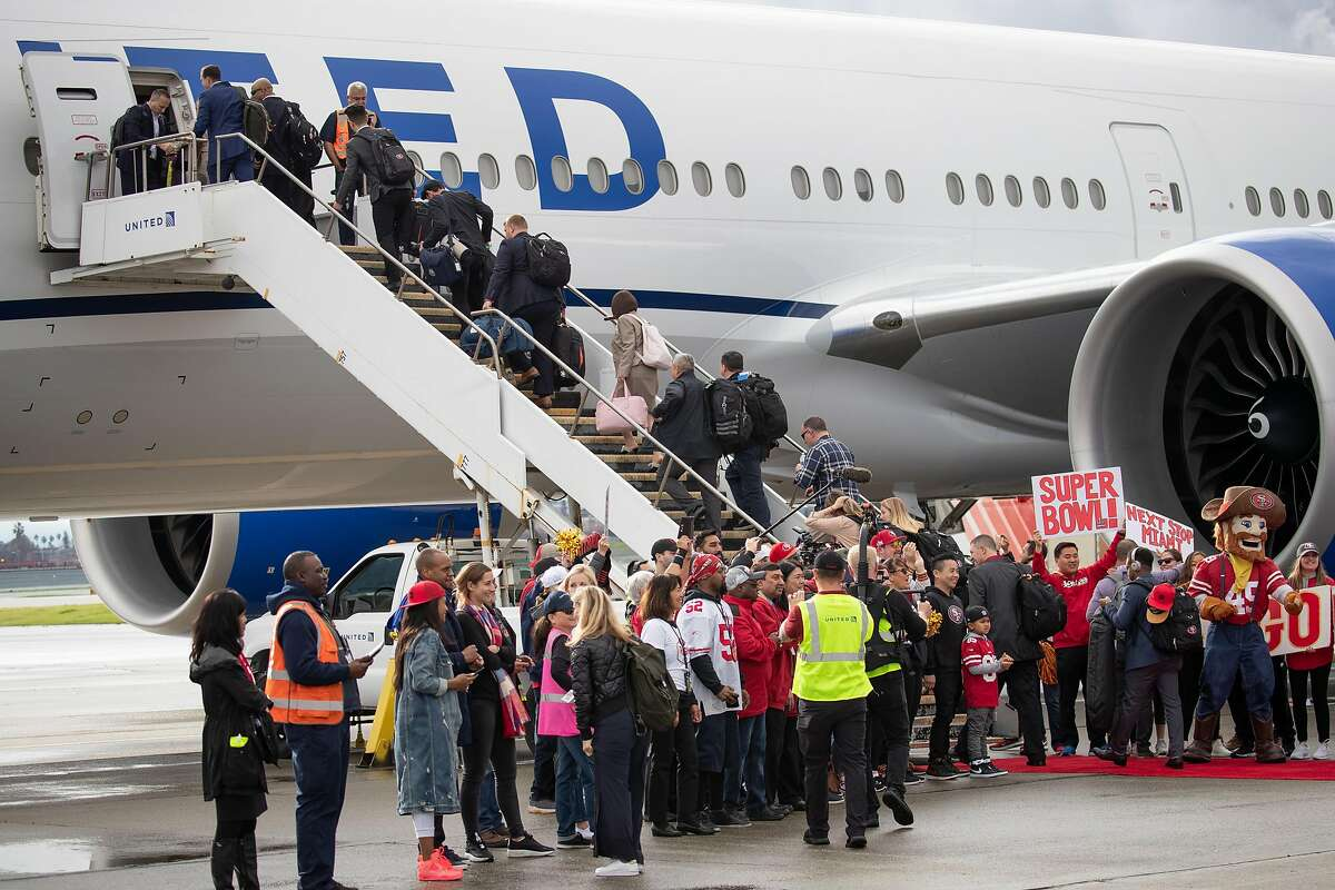 49ers front office staff boards the plane as the San Francisco 49ers depart on a chartered flight from Mineta San Jose International Airport Sunday, Jan. 26, 2020 in San Jose, Calif.