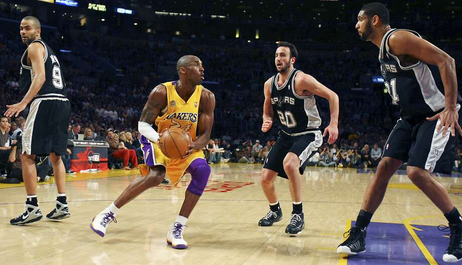 FOR SPORTS - Lakers' Kobe Bryant looks for room between the Spurs' Tony Parker, Manu Ginobili and Tim Duncan during second half action of game 1 in the NBA Western Conference Finals Wednesday May 21, 2008 at the Staples Center in Los Angeles, CA. The Lakers won 89-85. (PHOTO BY EDWARD A. ORNELAS/eornelas@express-news.net) Photo: Edward A. Ornelas, SAN ANTONIO EXPRESS-NEWS