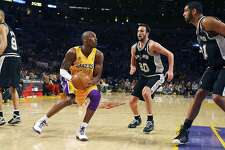 FOR SPORTS - Lakers' Kobe Bryant looks for room between the Spurs' Tony Parker, Manu Ginobili and Tim Duncan during second half action of game 1 in the NBA Western Conference Finals Wednesday May 21, 2008 at the Staples Center in Los Angeles, CA. The Lakers won 89-85. (PHOTO BY EDWARD A. ORNELAS/eornelas@express-news.net)