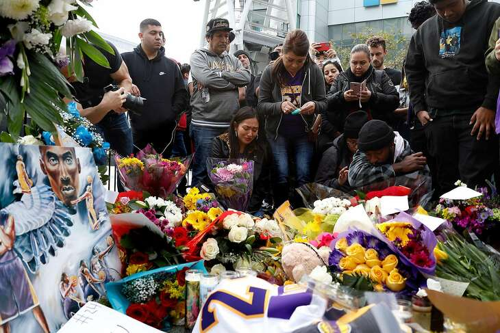 Fans gather near a memorial for Kobe Bryant, who died in a helicopter crash, on Sunday, Jan. 26, 2020, at Staples Center in Los Angeles, Calif. (Dania Maxwell/Los Angeles Times/TNS)