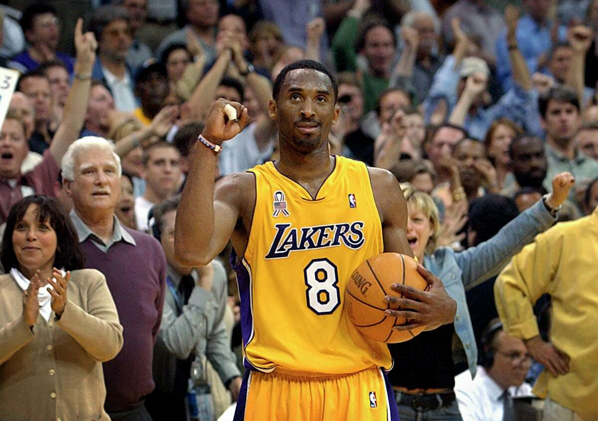FILE - In this May 14, 2002 file photo Los Angeles Lakers guard Kobe Bryant watches the clock run down the final seconds of Game 5 of their Western Conference semifinal against the San Antonio Spurs in Los Angeles. Bryant, the 18-time NBA All-Star who won five championships and became one of the greatest basketball players of his generation during a 20-year career with the Los Angeles Lakers, died in a helicopter crash Sunday, Jan. 26, 2020. He was 41. (AP Photo/Kevork Djansezian)