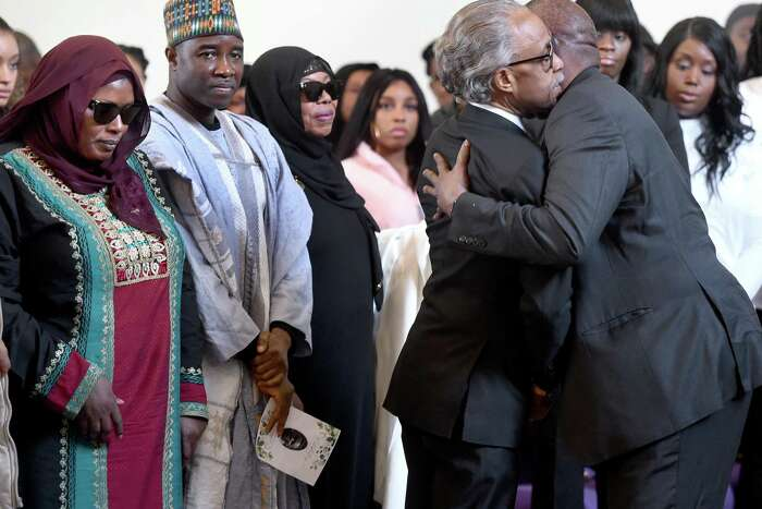 Rev. Al Sharpton (second from right) embraces Suhnoon Adams, great uncle of Mubarak Soulemane, during a memorial service for slain teen at First Calvary Baptist Church in New Haven on January 26, 2020. At far left is Mubarak's mother, Omo Mohammed.