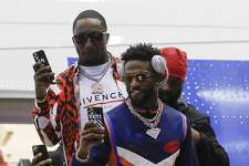 San Francisco 49ers' Emmanuel Sanders and Deebo Samuel arrive for the NFL Super Bowl 54 football game Sunday, Jan. 26, 2020, at the Miami International Airport in Miami. (AP Photo/Chris Carlson)