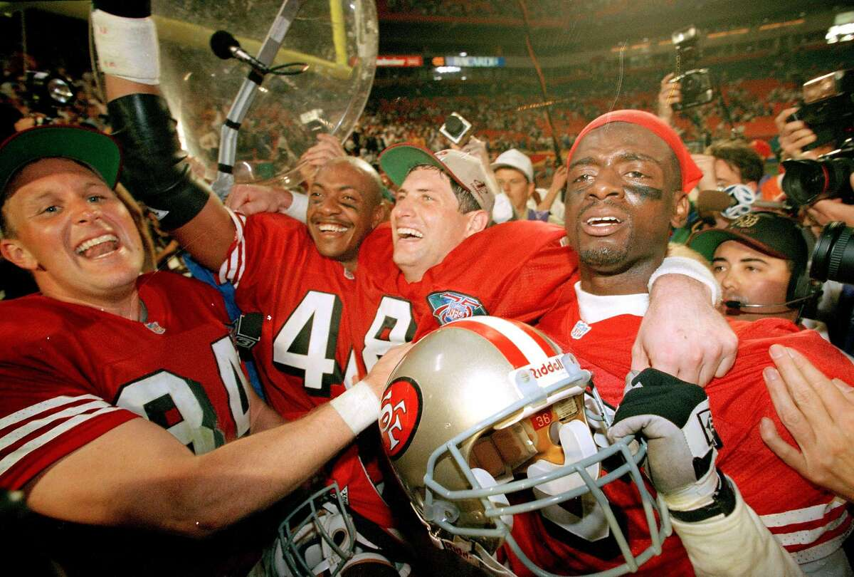 FILE - In this Jan. 29, 1995, file photo, San Francisco 49ers playes, from left, Brent Jones, William Floyd, Steve Young and Merton Hanks, celebrate after defeating after defeating the San Diego Chargers in Super Bowl XXIX at Miami's Joe Robbie Stadium.