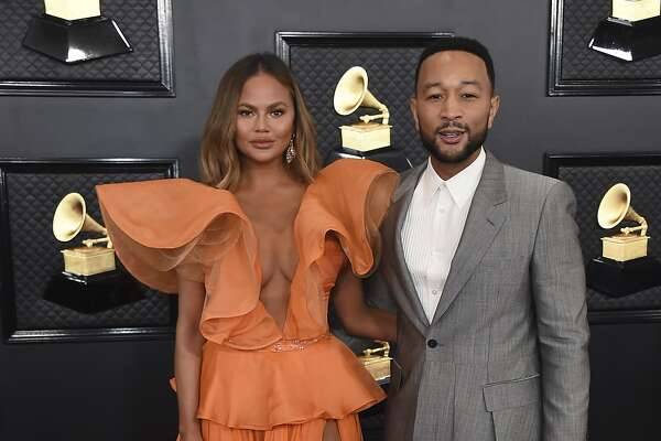 Chrissy Teigen, left, and John Legend arrive at the 62nd annual Grammy Awards at the Staples Center on Sunday, Jan. 26, 2020, in Los Angeles. (Photo by Jordan Strauss/Invision/AP)
