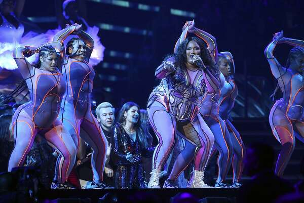 Lizzo, center, performs at the 62nd annual Grammy Awards on Sunday, Jan. 26, 2020, in Los Angeles. (Photo by Matt Sayles/Invision/AP)