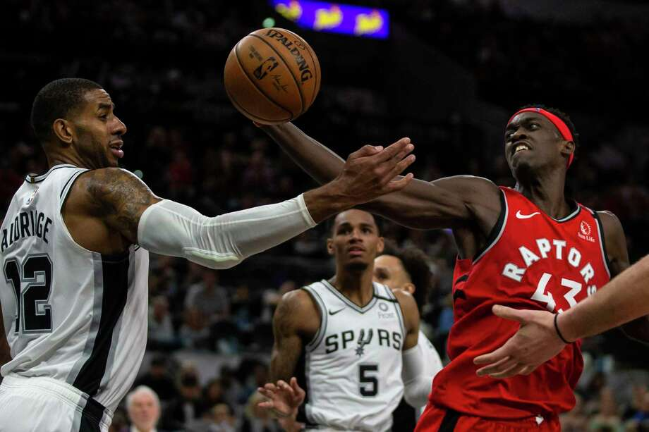 Toronto Raptors' Pascal Siaka, right, fights for the rebound with San Antonio Spurs' LaMarcus Aldridge as the Spurs host the Toronto Raptors at the AT&T Center in San Antonio, Texas, Jan. 26, 2020. Photo: Josie Norris /Staff Photographer / **MANDATORY CREDIT FOR PHOTOG AND SAN ANTONIO EXPRESS-NEWS/NO SALES/MAGS OUT/TV