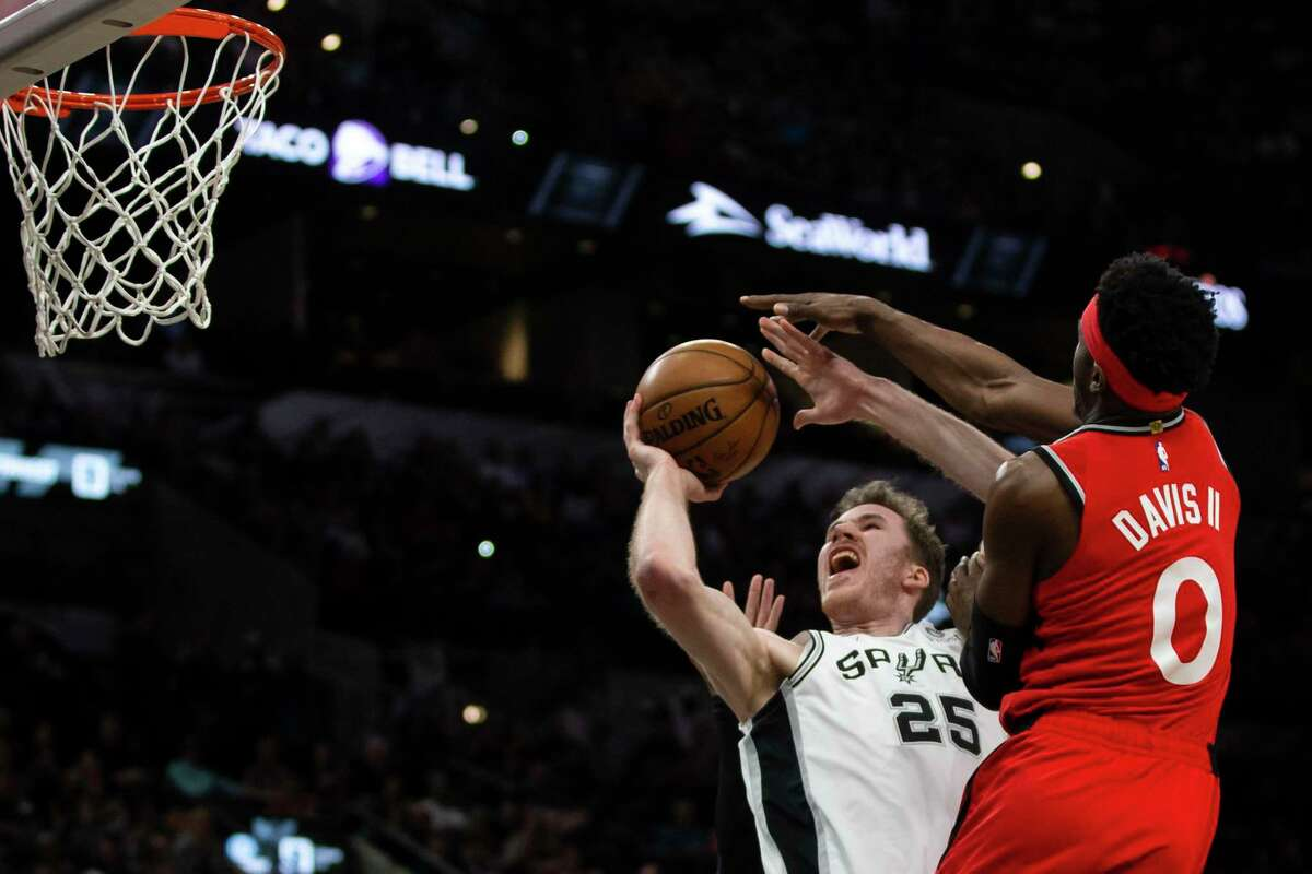 """The Spurs' Jakob Poeltl, left, said the team's first five-on-five scrimmage in four months was scrappy. """"It's a bit like a training camp vibe. We just need to build that chemistry again,"""" he said."""