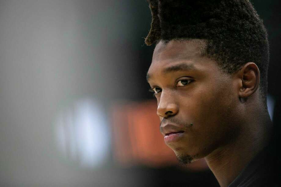 The Spurs' Lonnie Walker IV was known for his tall hair, but after cutting it off he says he used his hair to cover up his pain. Photo: Josie Norris / Staff Photographer / **MANDATORY CREDIT FOR PHOTOG AND SAN ANTONIO EXPRESS-NEWS/NO SALES/MAGS OUT/TV