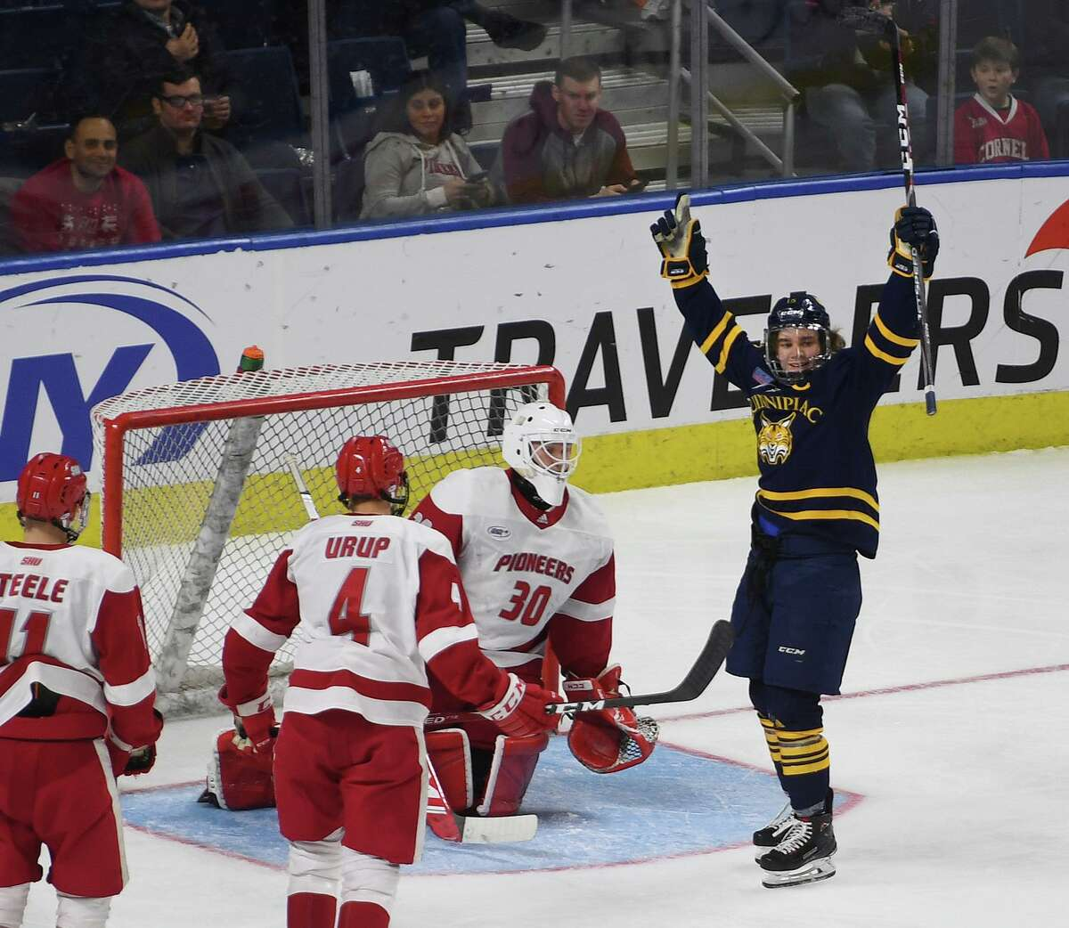 Quinnipiac captain Nick Jermain celebrates a goal by teammate Karlis Cukste in the first period of the championship game with Sacred Heart at the Connecticut Ice college hockey tournament at the Webster Bank Arena in Bridgeport, Conn. on Sunday January 26, 2020.