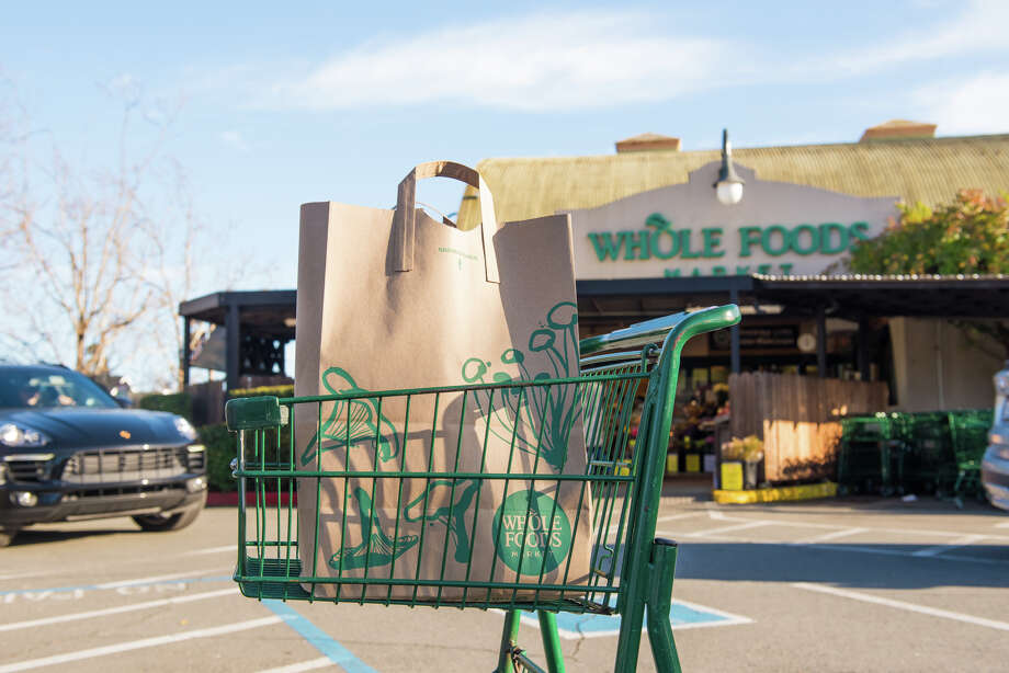 Walking into each grocery store, we examined the price of a gallon of milk, a loaf of bread, a dozen eggs, a Fuji apple and boneless skinless chicken breast. Photo: Blair Heagerty / SFGate