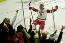 Sacred Heart's Ryan Steele celebrates a goal in the championship game of the Connecticut Ice Festival on Sunday in Bridgeport.