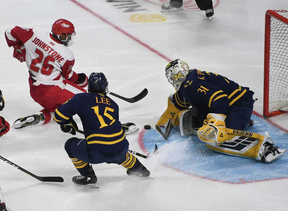Quinnipiac goalie Keith Petruzzelli stops a shot from Sacred Heart's Marc Johnstone in the second period of the championship game of the Connecticut Ice tournament at the Webster Bank Arena in Bridgeport in January.