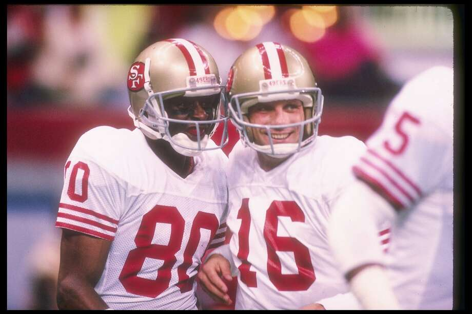 San Francisco 49ers quarterback Joe Montana (right) and wide receiver Jerry Rice celebrate a Super Bowl win over the Denver Broncos in 1990. Photo: Rick Stewart / Getty Images 1990