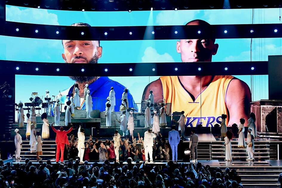 LOS ANGELES, CALIFORNIA - JANUARY 26: Images for the late Nipsey Hussle and Kobe Bryant are projected onto a screen while YG, John Legend, Kirk Franklin, DJ Khaled, Meek Mill, and Roddy Ricch perform onstage during the 62nd Annual GRAMMY Awards at STAPLES Center on January 26, 2020 in Los Angeles, California. (Photo by Kevin Winter/Getty Images for The Recording Academy )Meek Mill