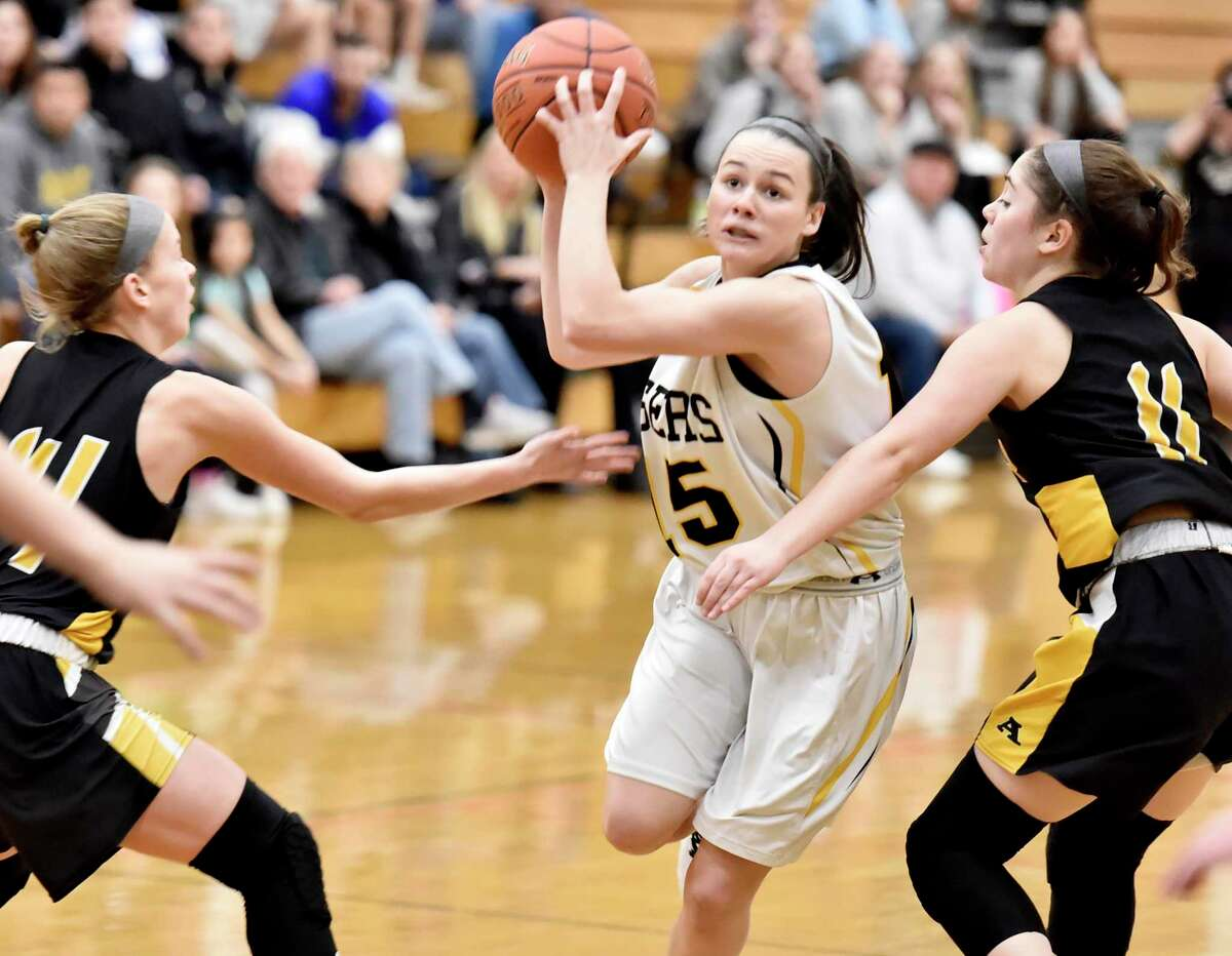 Madison, Connecticut -Wednesday, January 10, 2020: Sara Wohlgemuth of Daniel Hand H.S. drives to the basket against Amity H.S. during the first quarter of girls basketball Friday evening at Daniel Hand H.S.
