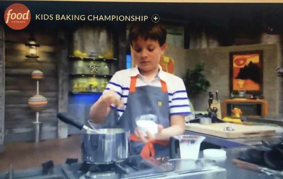 "Sam Occhiogrosso, 11, or West Hartford, has made it through three episodes on the reality show ""Kids Baking Championship,"" airing Monday nights at 9 p.m. on the Food Network. Photo: The Food Network"