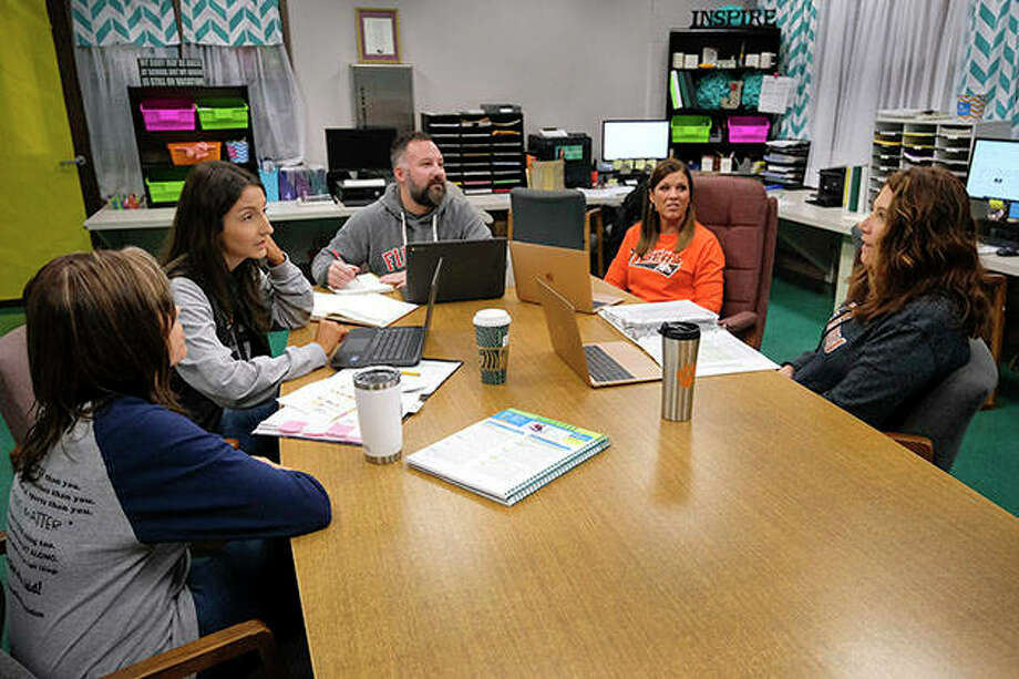 Instructional reading specialist Jennifer McCabe (from left), teacher Chloe Isbell, teacher Nathan Robinette, instructional math specialist Heather Sunny and instructional reading specialist Tara Brandon discuss a new math curriculum during a meeting at Herrin Elementary School in Herrin. The school's instructional specialists are helping teachers with instruction and classroom management to help improve their students' performance. Photo: Byron Hetzler | Southern Illinoisan (AP)