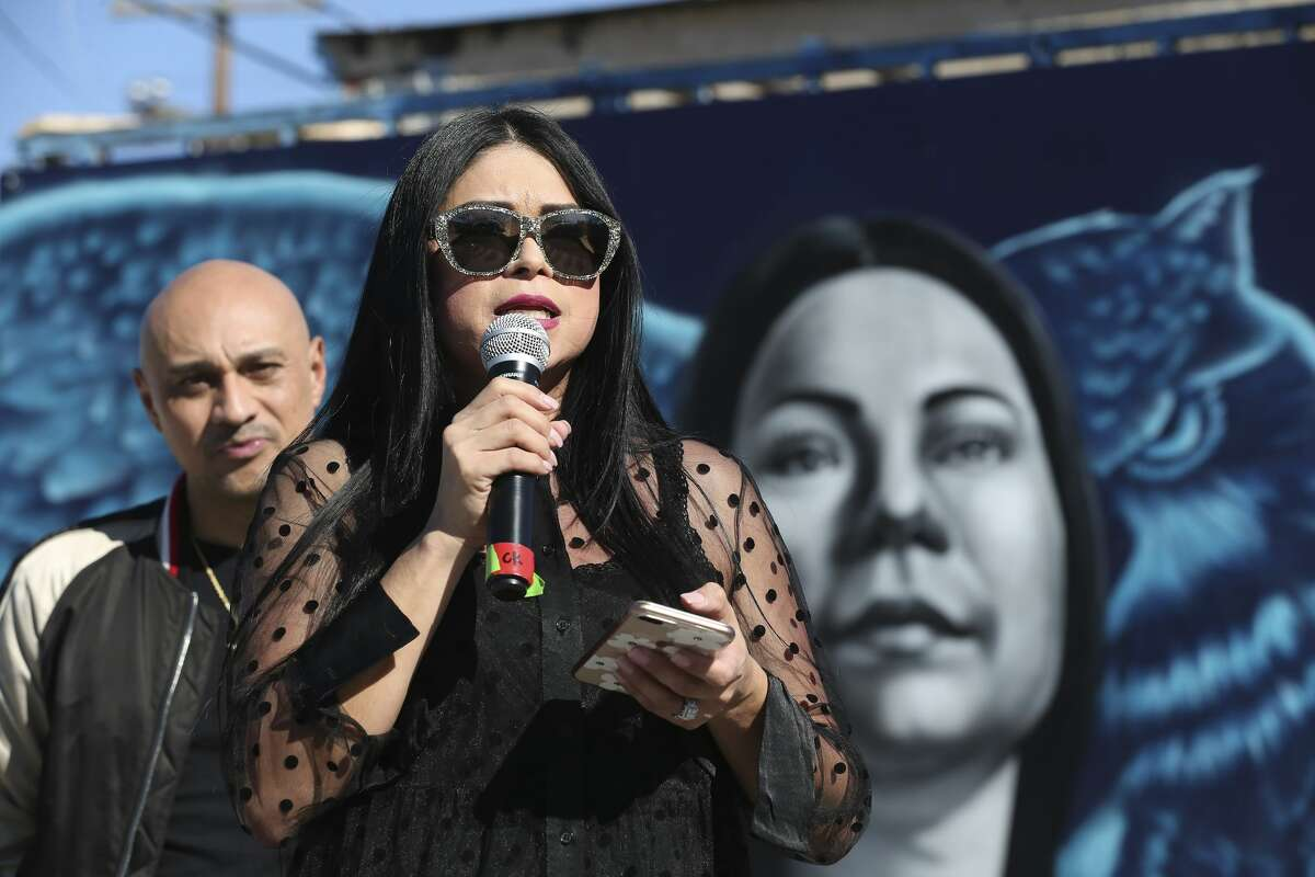 Jacqueline Becerra, a local nursing director, pastor and philanthropist, speaks as her portrait in a mural is unveiled on the side of Botello Food Store in the city's Westside, Sunday, Jan. 26, 2020. The with a mural is located in the underserved area of San Antonio where Becerra grew up. The mural �
