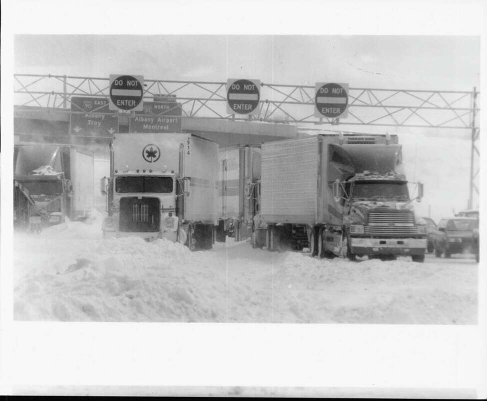 Exit 24 of New York State Thruway - Blizzard '93 - tractor-trailers and autos line up for the eventual reopening of the New York State Thruway this afternoon. Blowing snow will still keep westbound traffic off the Thruway. March 14, 1993 (Skip Dickstein/Times Union Archive)