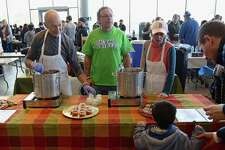 Longtime Westporters Stephen Carpentieri, owner of Dunville's, and his parents Joseph and Roz meet a new customer at The Great Mac & Chili Challenge on Sunday, Jan. 26, 2020, at the SoNo Collection mall in Norwalk, Conn.