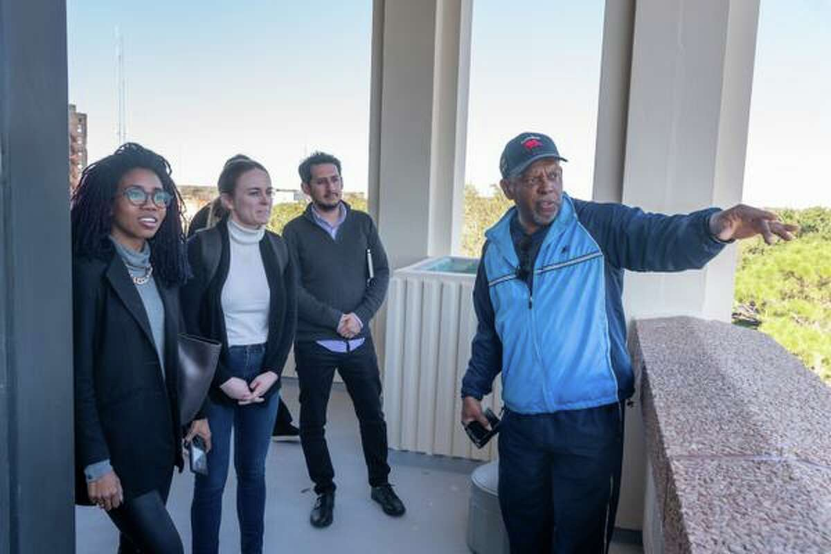 John Beard, executive director of Port Arthur Community Action Network, right, gives students, Erick Diaz, Stephanie Thomas, and Brooke Wages a bird's eye tour of the city from the observation deck at city hall. Harvard students from the Center for Public Leadership visited Port Arthur to gain insight from city leaders and the community regarding their issues, and also how communities of color can be assisted in addressing those challenges. Photo made on January 24, 2020. Fran Ruchalski/The Enterprise