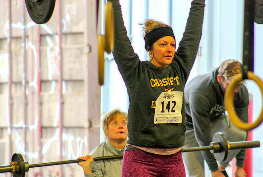 Participants take on the barbells during CrossFit Edwardsville's first 5K & Fran-K event Saturday in Glen Carbon. Photo: Andrew Malo For The Intelligencer