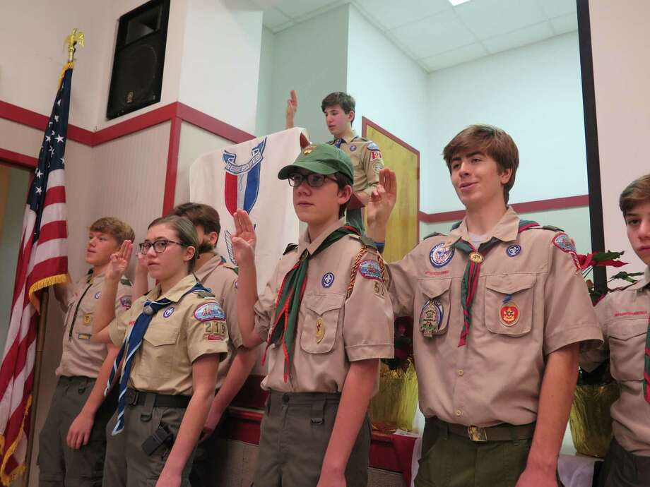 Troop 53 be gins the ceremony with new Eagle Scout and Senior Patrol Leader Maximus Racanelli (at podium) leading Scouts from Troops 53 and 219 in the Scout Oath and Scout Law. Photo: Laura Racanelli