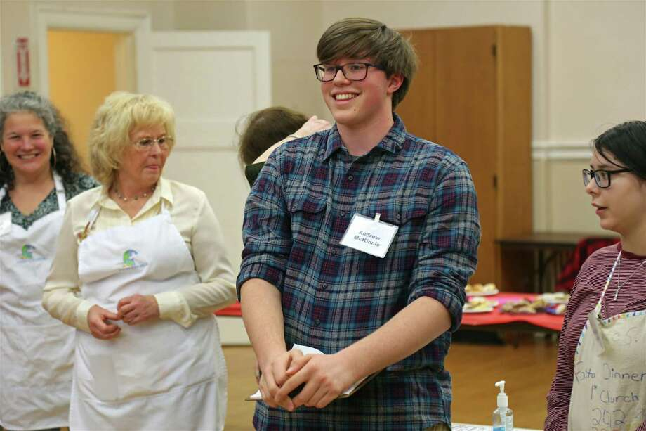 Event organizer Andrew McKinnis, 15, of Fairfield, gives some last-minute direction to volunteers at the 9th annual Deacons' Fund Pasta Dinner at First Church Congregational on Sunday, Jan. 26, 2020, in Fairfield, Conn. Photo: Jarret Liotta / Jarret Liotta / ©Jarret Liotta 2020