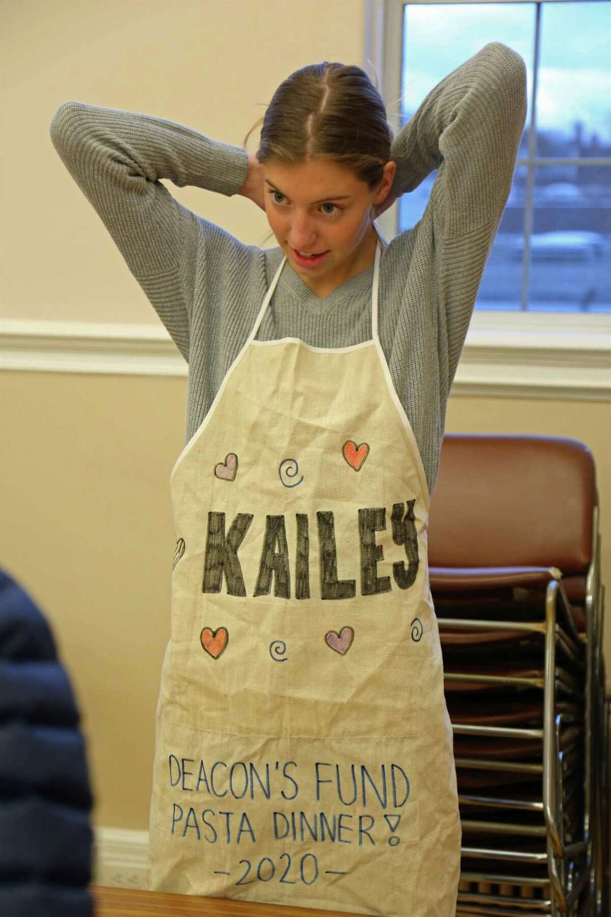 Kailey Wackerman, 14, of Fairfield, suits up for the 9th annual Deacons' Fund Pasta Dinner at First Church Congregational on Sunday, Jan. 26, 2020, in Fairfield, Conn.