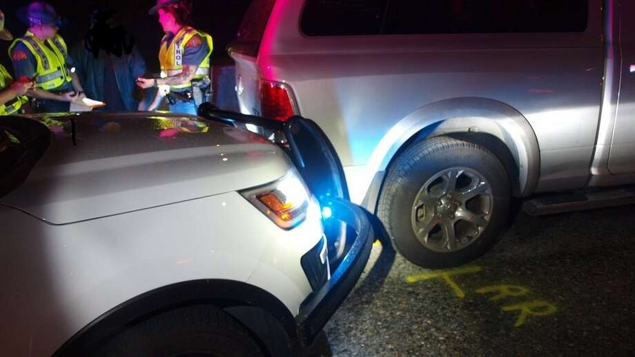 A trooper uses his patrol car to stop an SUV that was rolling backwards on I-5. (Photo: Washington State Patrol) Photo: Courtesy WSP