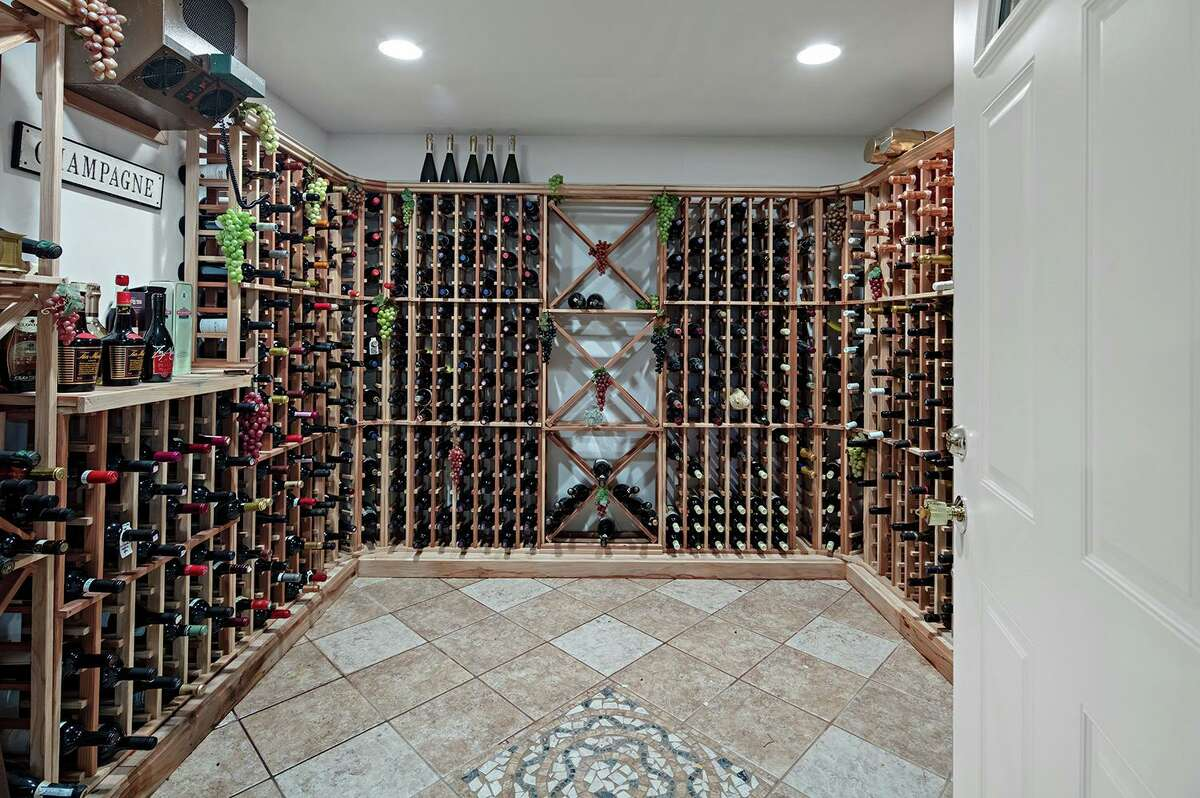 In the full partially finished walk-out basement there is a 1,500-bottle wine cellar with a stone floor.
