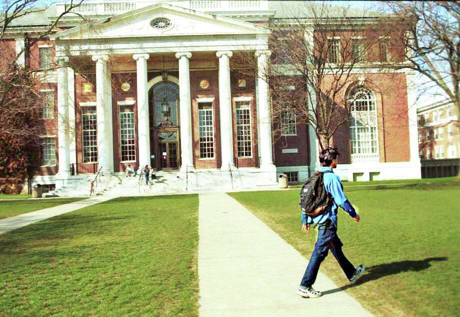 A student walks across the Wesleyan University campus on High Street in Middletown in this pre-pandemic shot. Photo: Hearst Connecticut Media File Photo